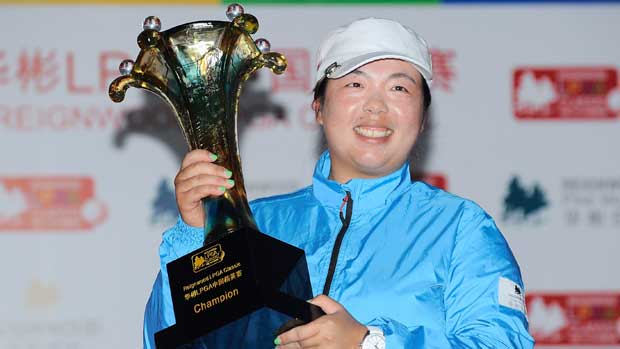 Shanshan Feng holds the trophy during the Reignwood LPGA Classic