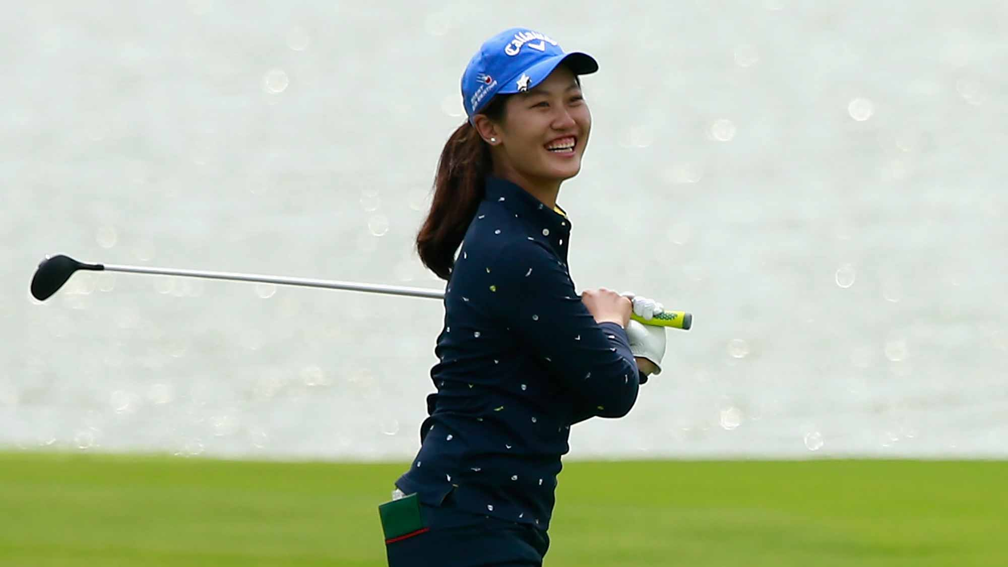 Xiyu Lin of China reacts after her approaching shot to 18th hole during Round 2 of Blue Bay LPGA