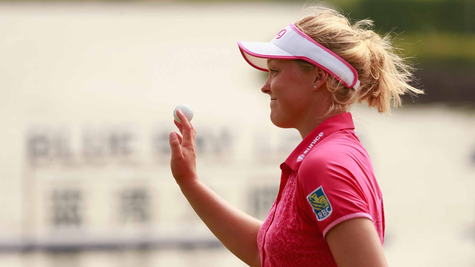 Brooke M. Henderson of Canada acknowledge to spectators after her putt at 18th hole in Round 3 of Blue Bay LPGA of Day 3