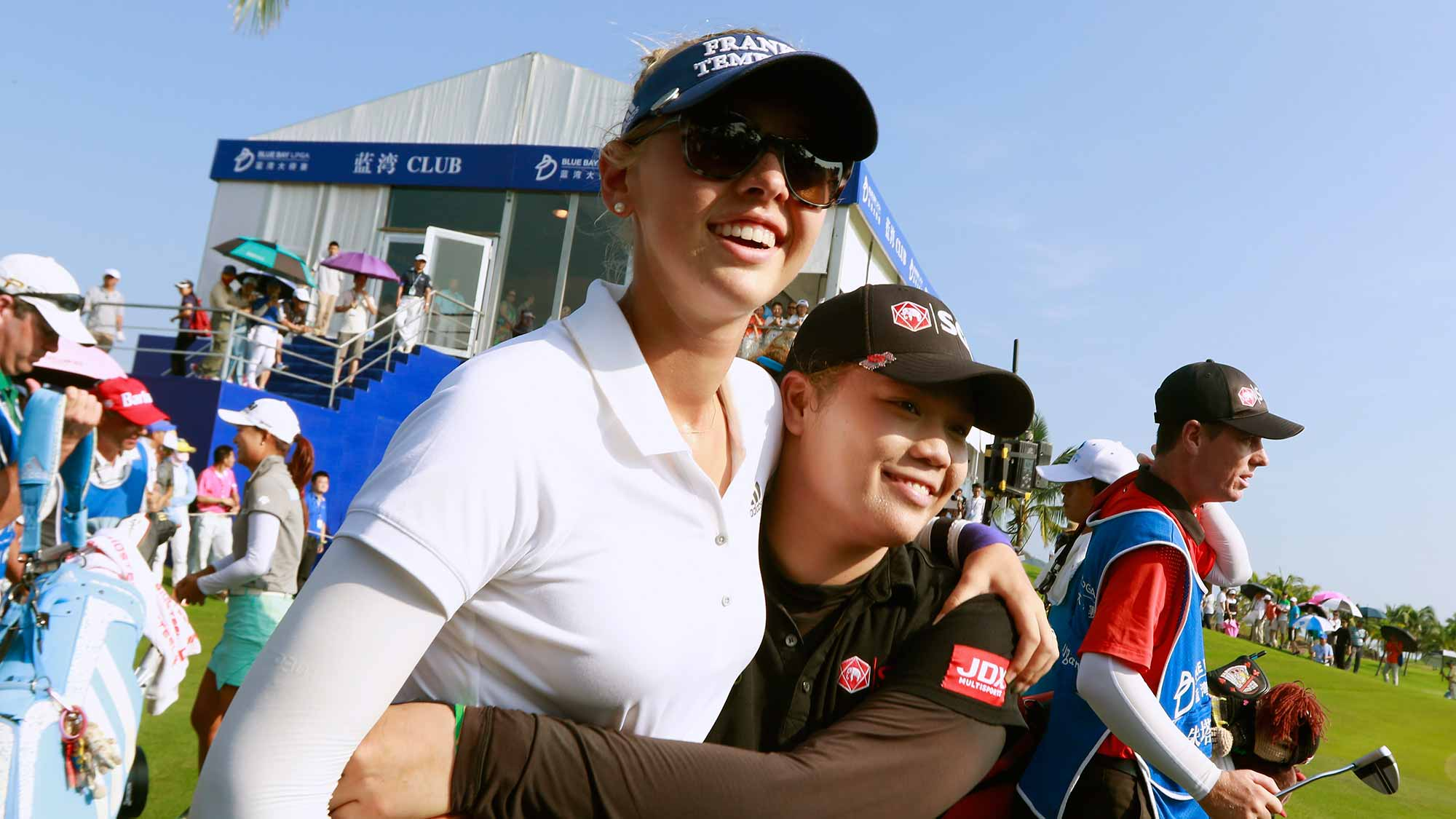 Ariya Jutanugarn of Thailand and Jessica Korda interact on the 18th green after the final round of the Blue Bay LPGA on Day 4