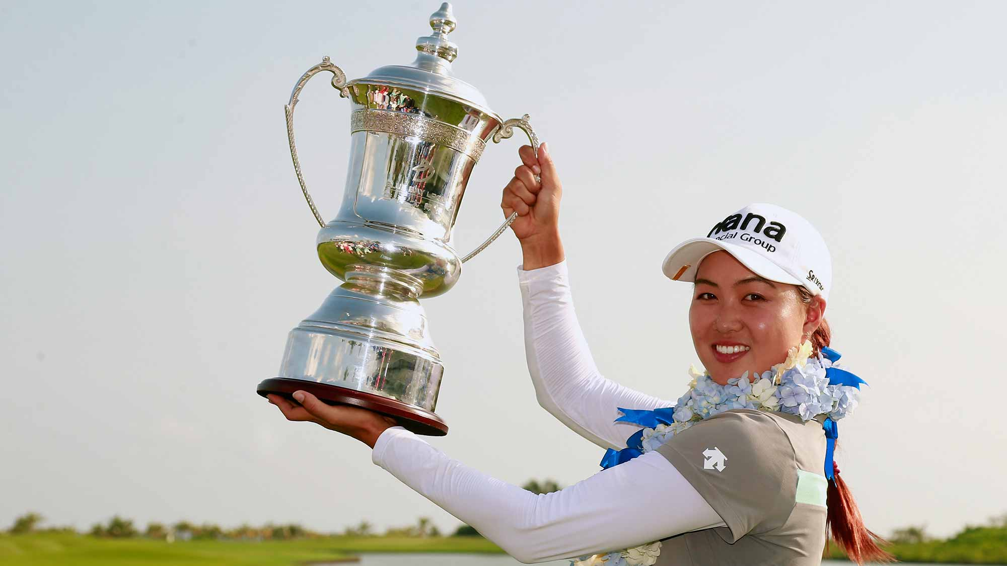Minjee Lee of Australia poses with her trophy after winning the Blue Bay LPGA on Day 4