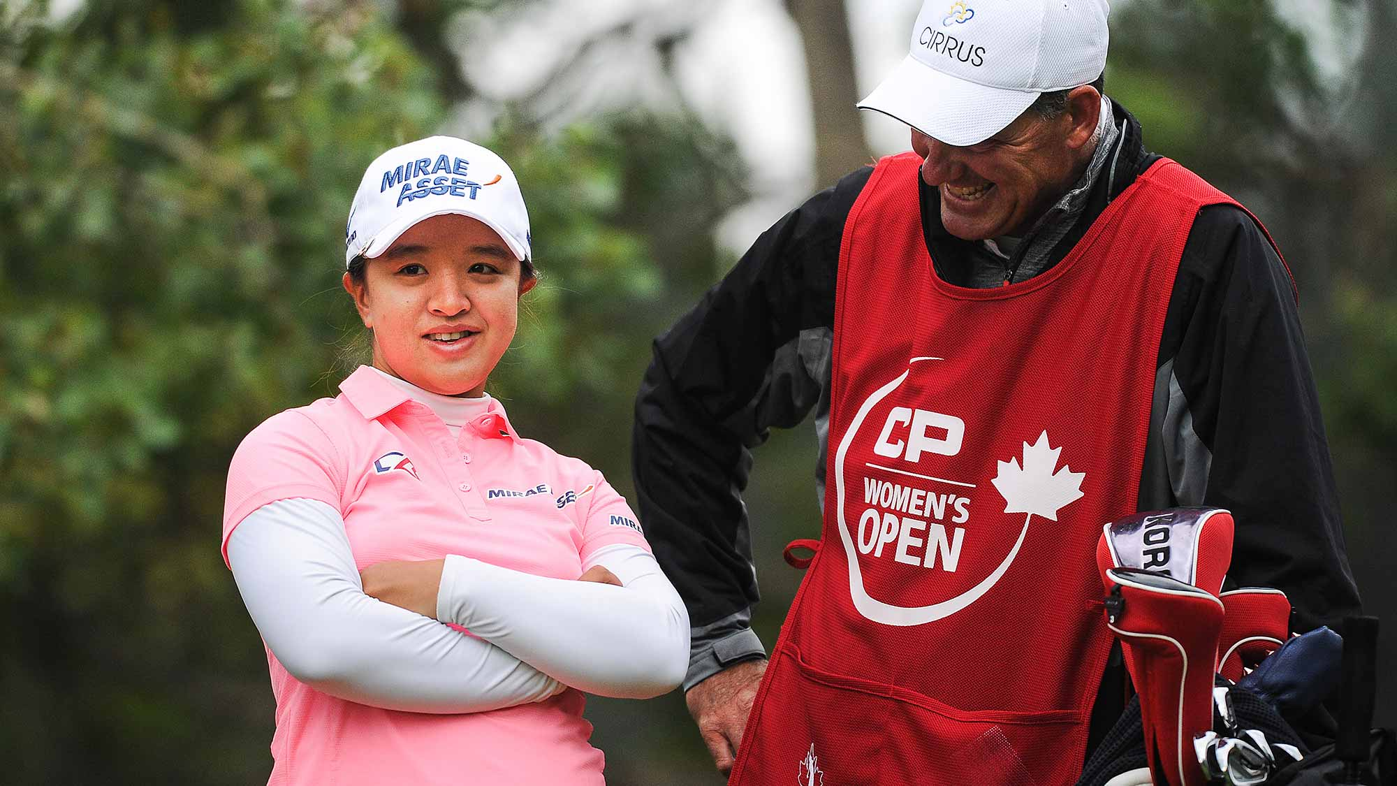 Sei Young Kim of South Korea laughs with her caddy prior to her tee shot on the 11th hole during the first round of the Canadian Pacific Women's Open at Priddis Greens Golf and Country Club