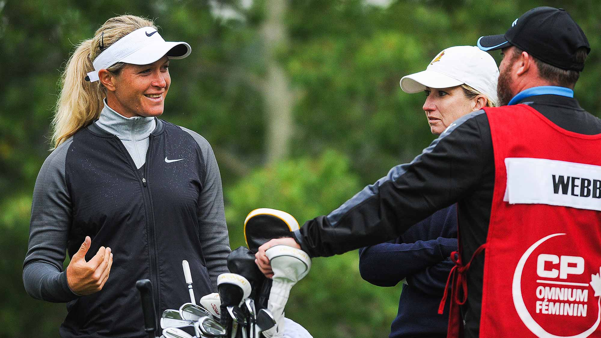 Suzann Pettersen of Norway talks with Karrie Webb of Australia prior to teeing off on the 11th hole during the first round of the Canadian Pacific Women's Open at Priddis Greens Golf and Country Club
