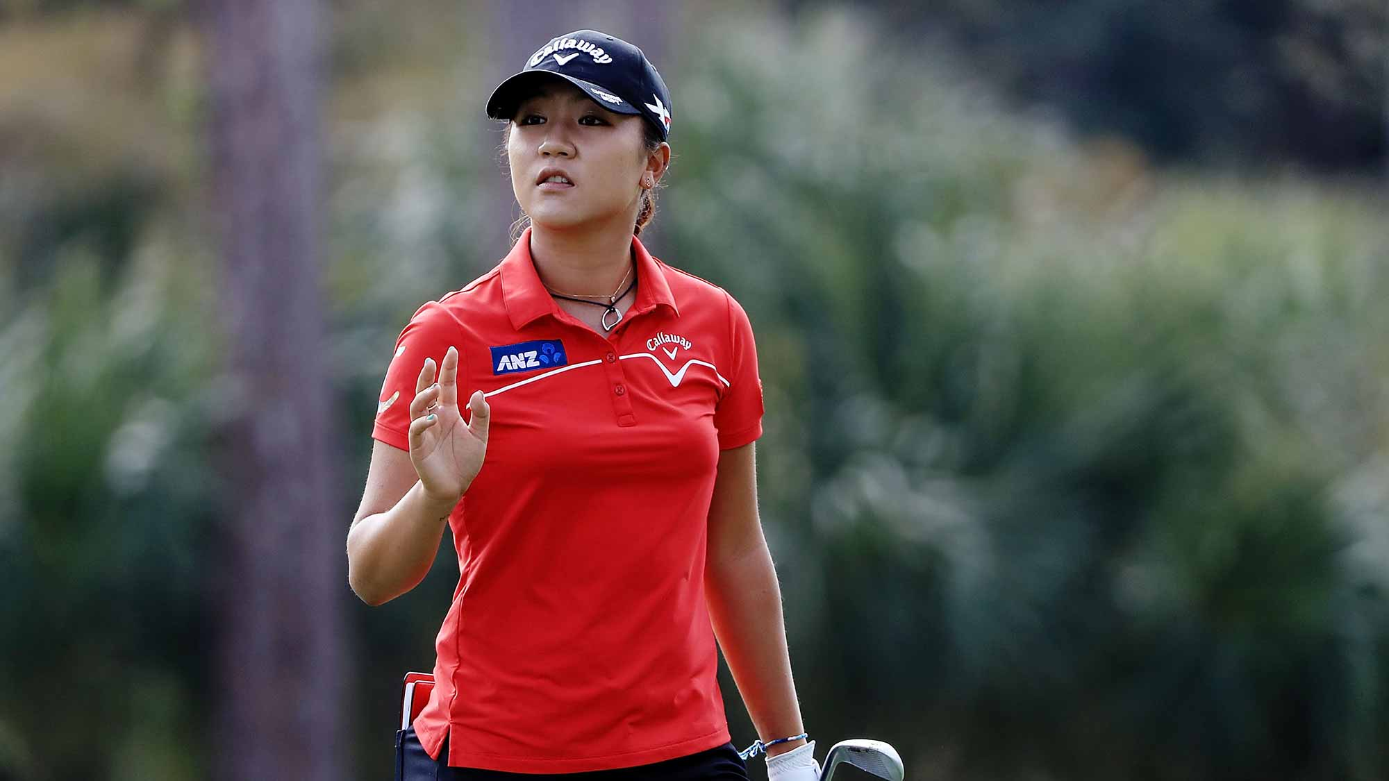 Lydia Ko of New Zealand waves to the crowd on the second hole during the second round of the CME Group Tour Championship at Tiburon Golf Club