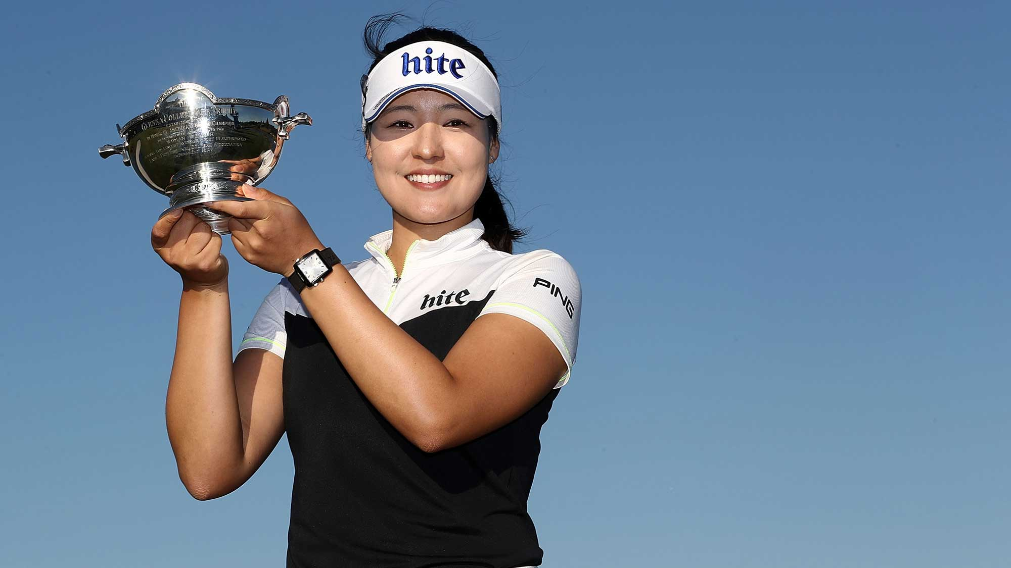 In Gee Chun of Korea poses with the Vare trophy during the final round of the CME Group Tour Championship at Tiburon Golf Club