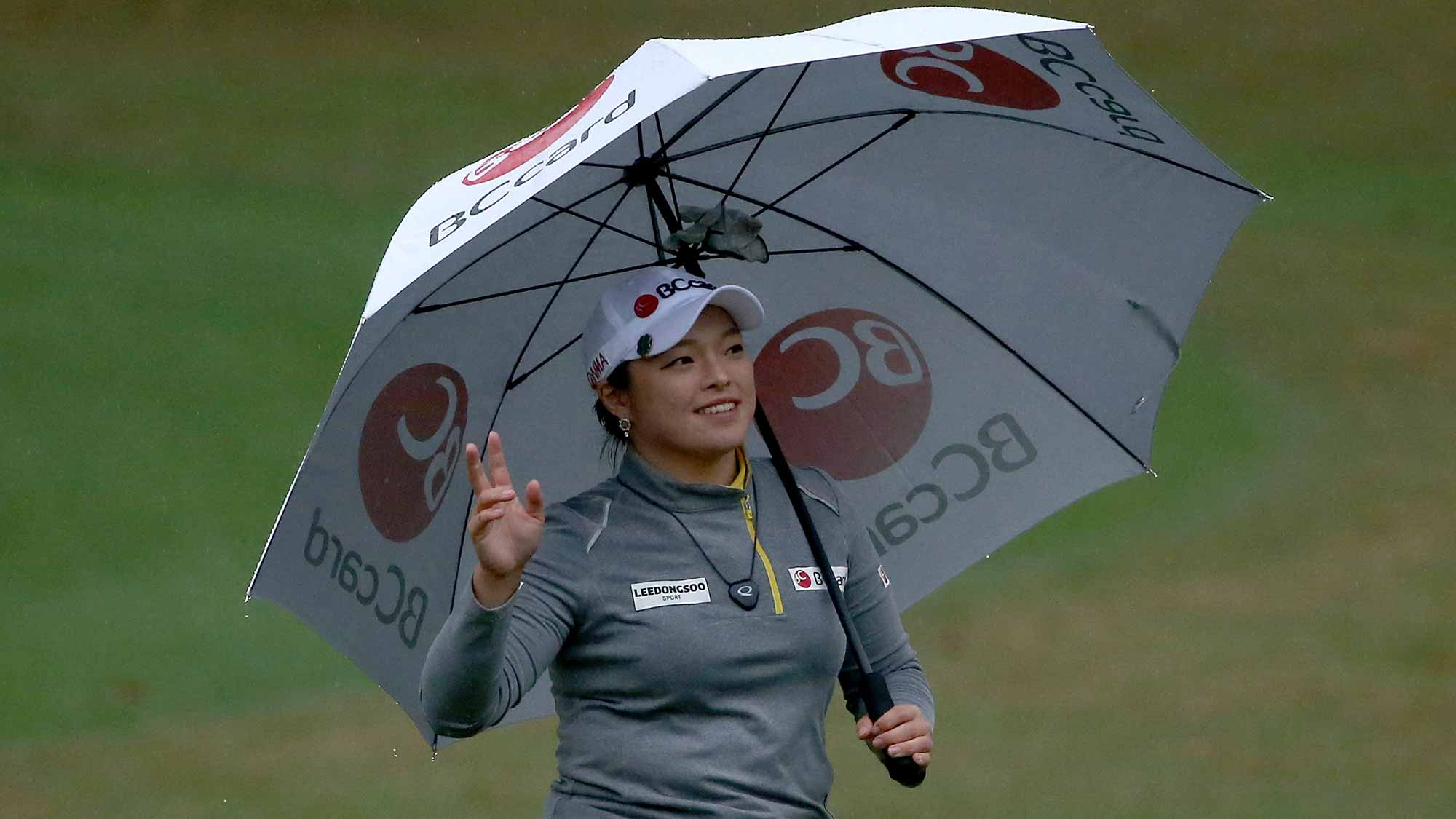 Ha Na Jang of South Korea acknowledges the crowd on the 18th hole during the final round of the Coates Golf Championship Presented By R+L Carriers at Golden Ocala Golf Club