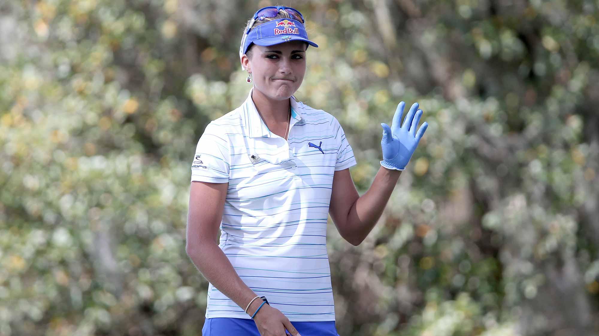 Lexi Thompson of the United States acknowledges the crowd on the first hole during the first round of the Coates Golf Championship Presented By R+L Carriers at Golden Ocala Golf Club