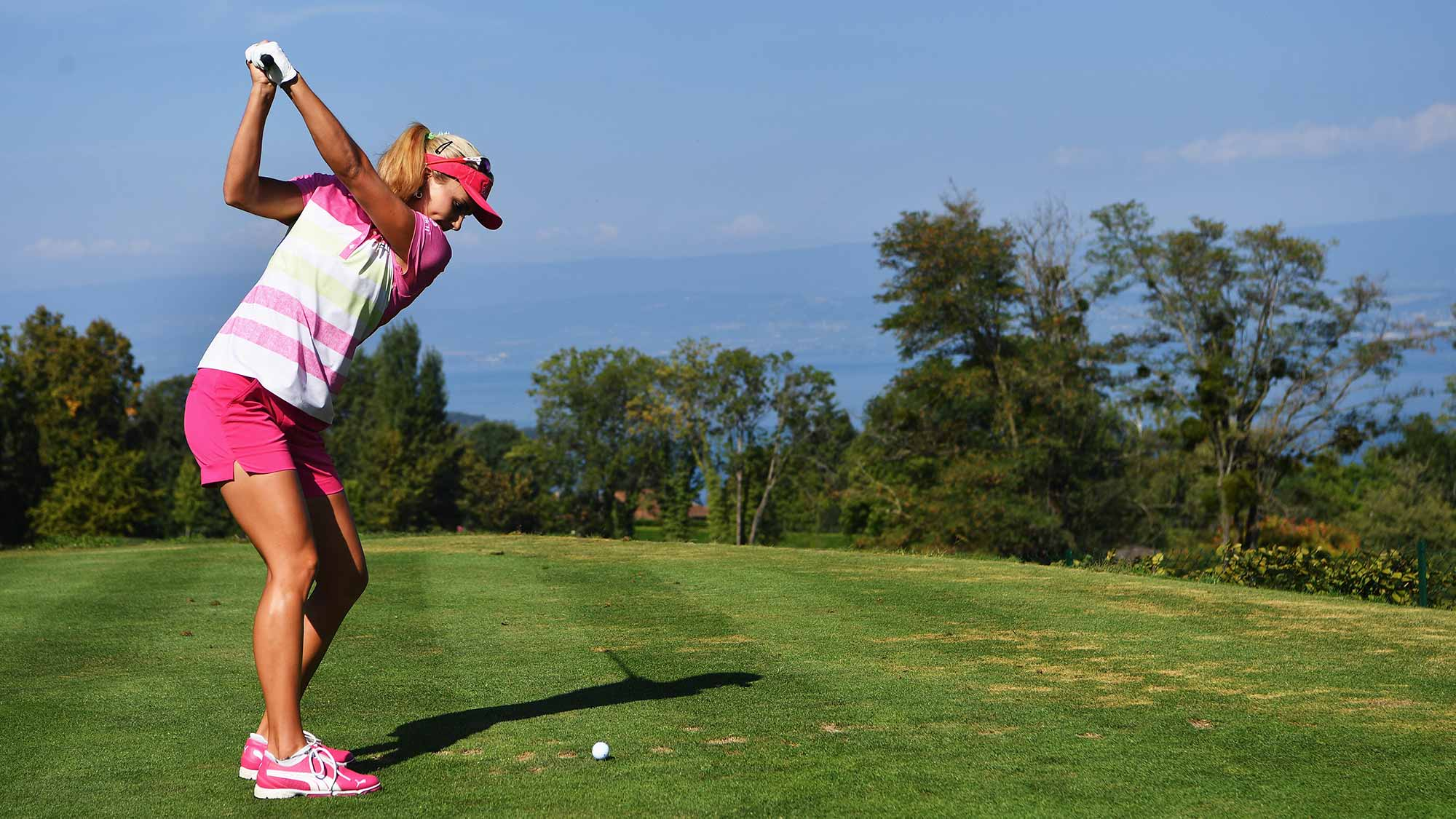 Lexi Thompson of USA plays a shot during practice prior to the start of the Evian Championship
