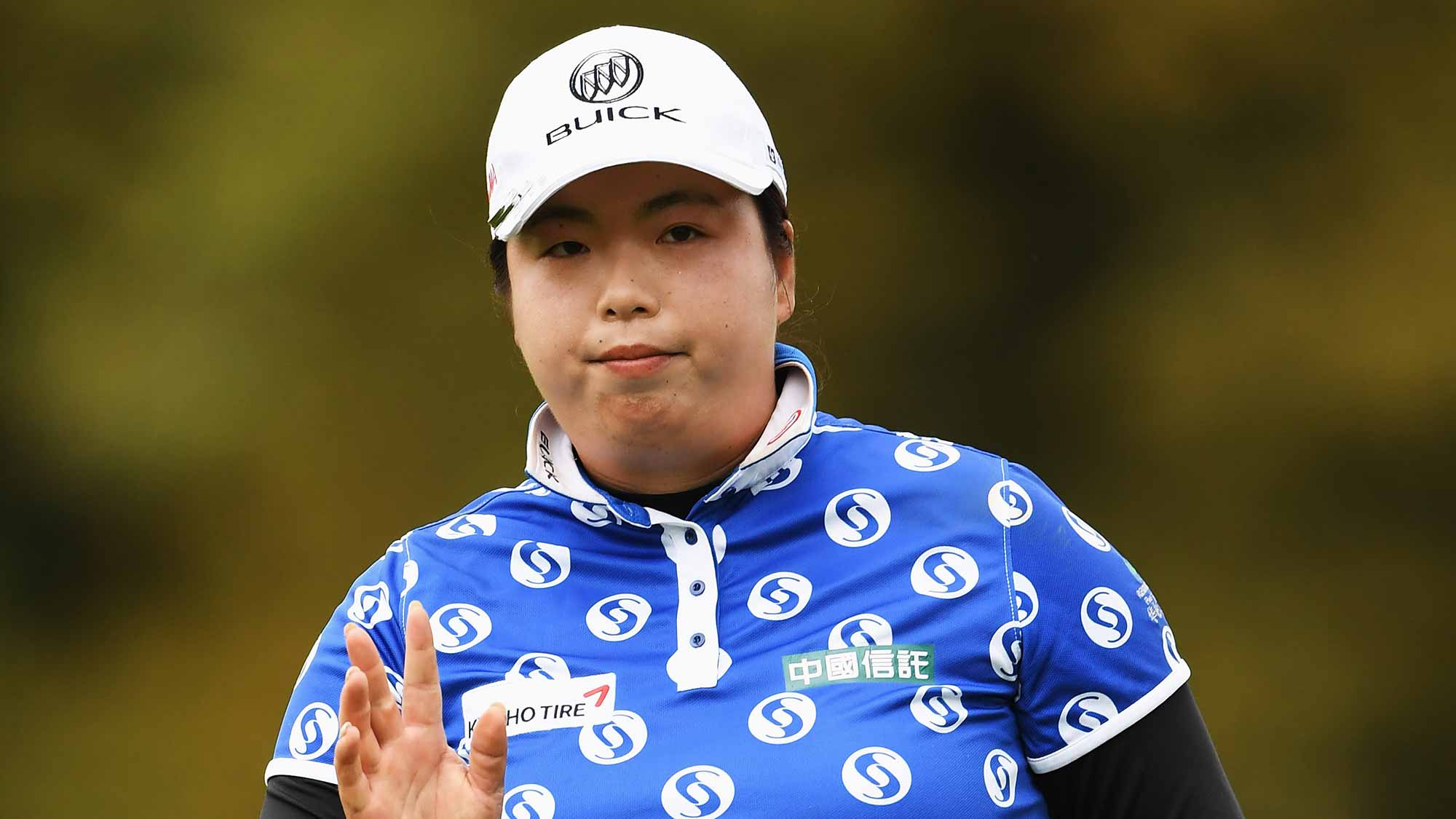 Shanshan Feng of China reacts to a putt during the second round of The Evian Championship