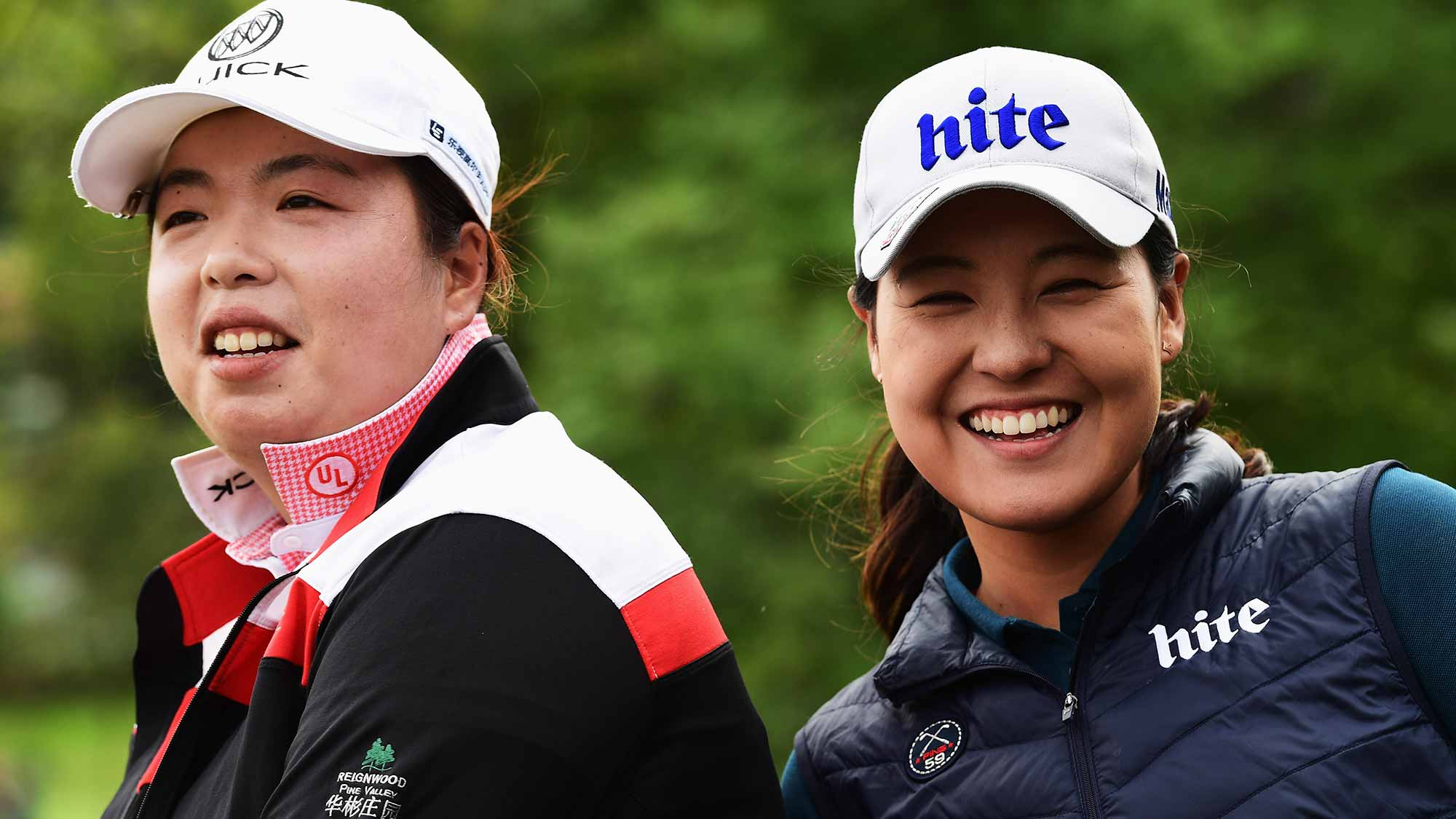 Shanshan Feng of China and In Gee Chun of Korea look on during the third round of The Evian Championship