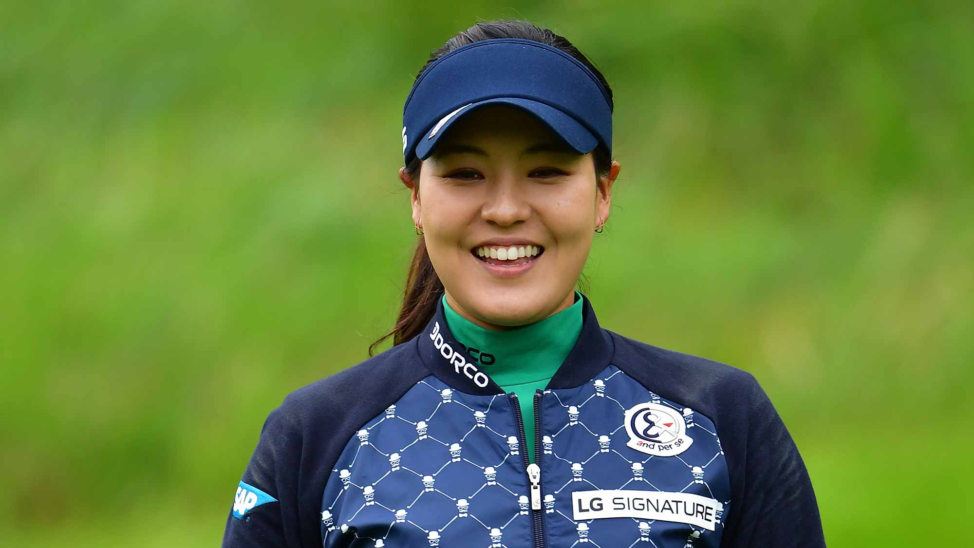Defending Champion In Gee Chun of South Korea waves during the pro-am prior to the start of the Evian Championship at Evian Resort Golf Club