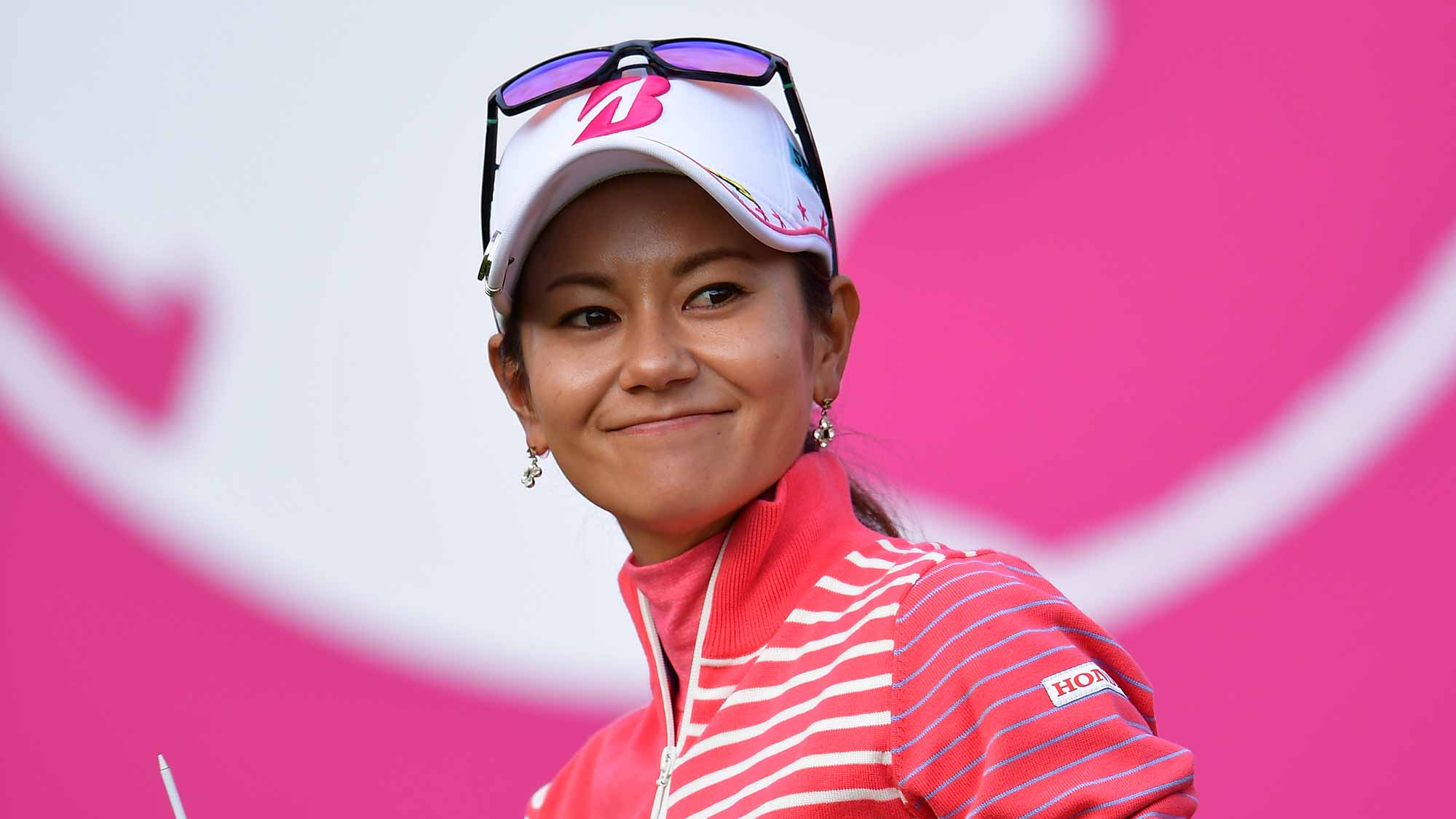 Ai Miyazato of Japan waves to fans as she makes her final competency round of golf during the final round of the Evian Championship at Evian Golf Club