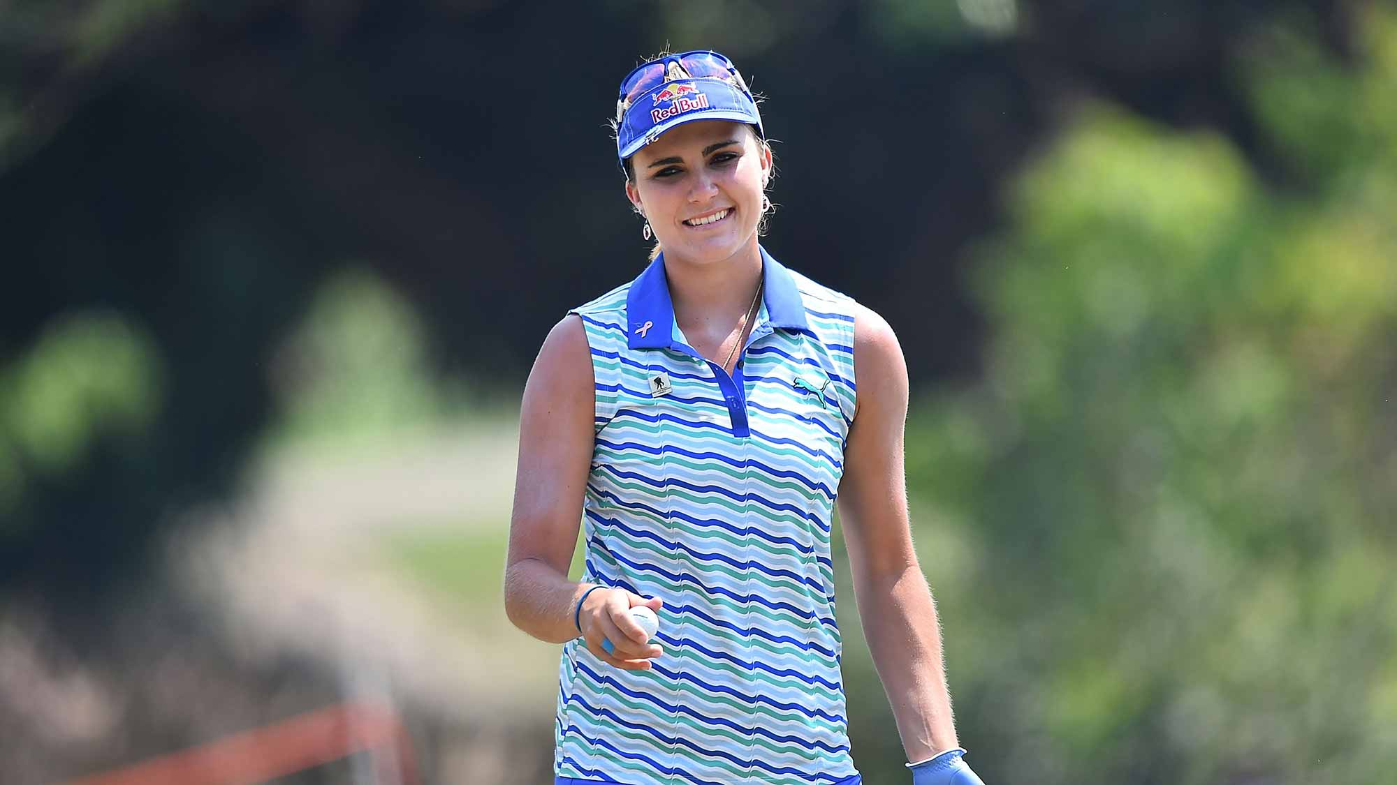 Lexi Thompson of the United States acknowledges the fan during day four of the 2016 Honda LPGA Thailand at Siam Country Club