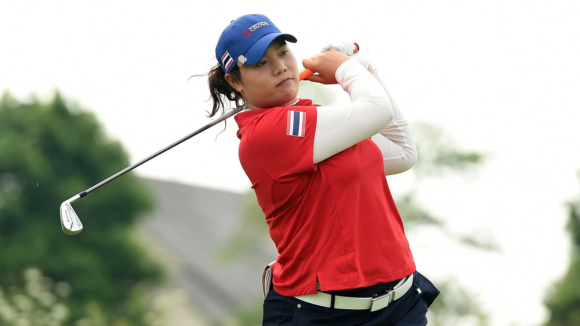 Ariya Jutanugarn of Thailand hits her tee shot on the fourth hole during the four-ball session of the 2016 UL International Crown at the Merit Club