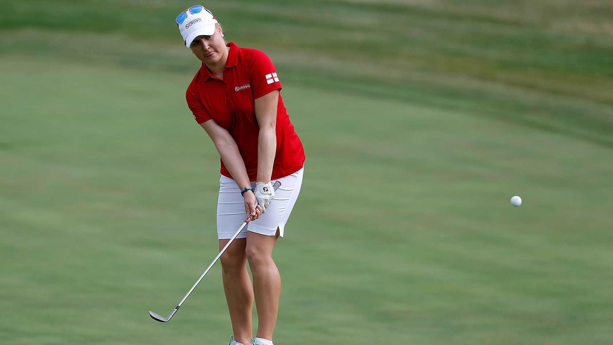 Charley Hull of England chips to the second hole during the four-ball session of the 2016 UL International Crown at the Merit Club