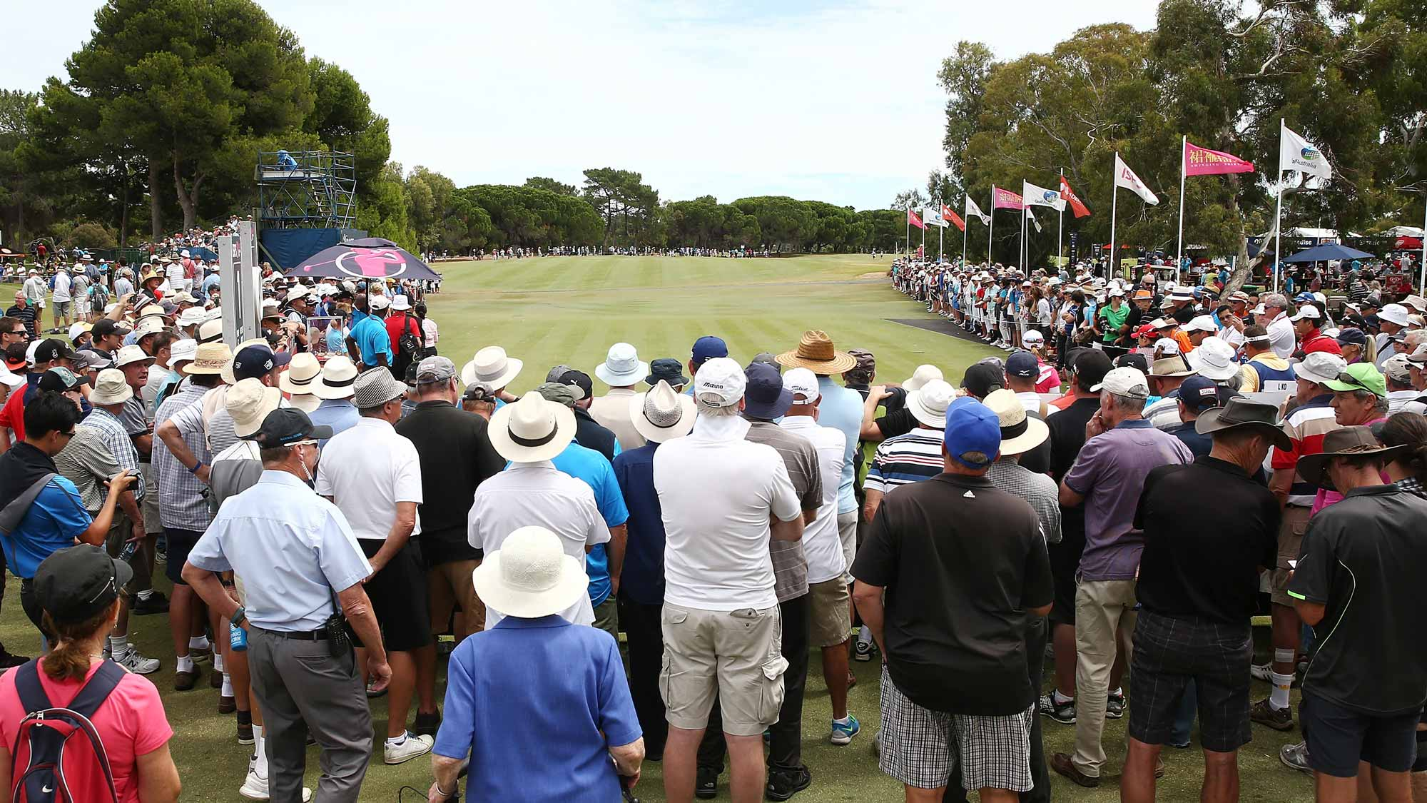 Spectators look on as Lydia Ko of New Zealand tees off during day two of the ISPS Handa Women's Australian Open at The Grange GC