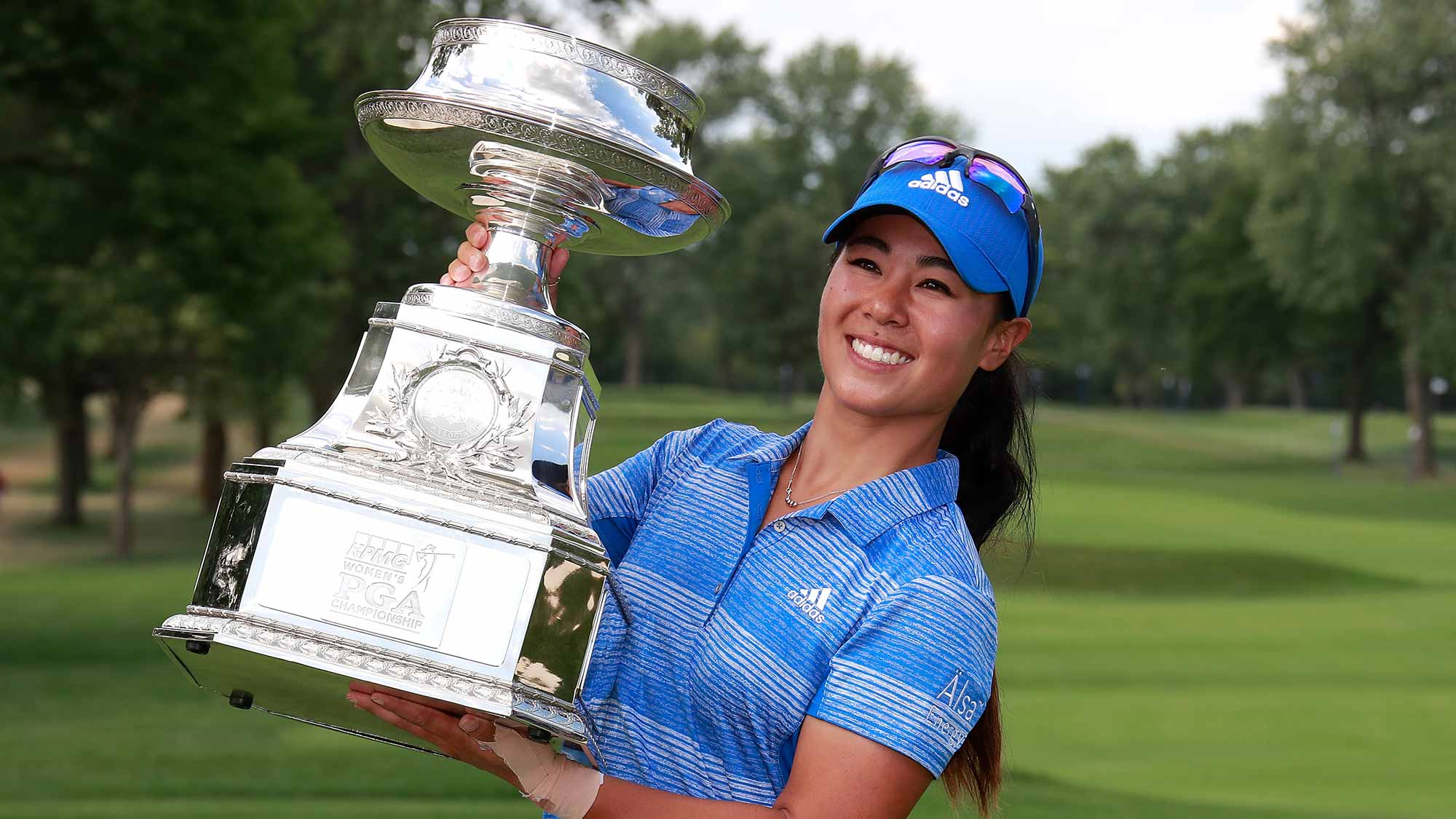 Danielle Kang poses with the championship trophy after winning the 2017 KPMG PGA Championship at Olympia Fields Country Club