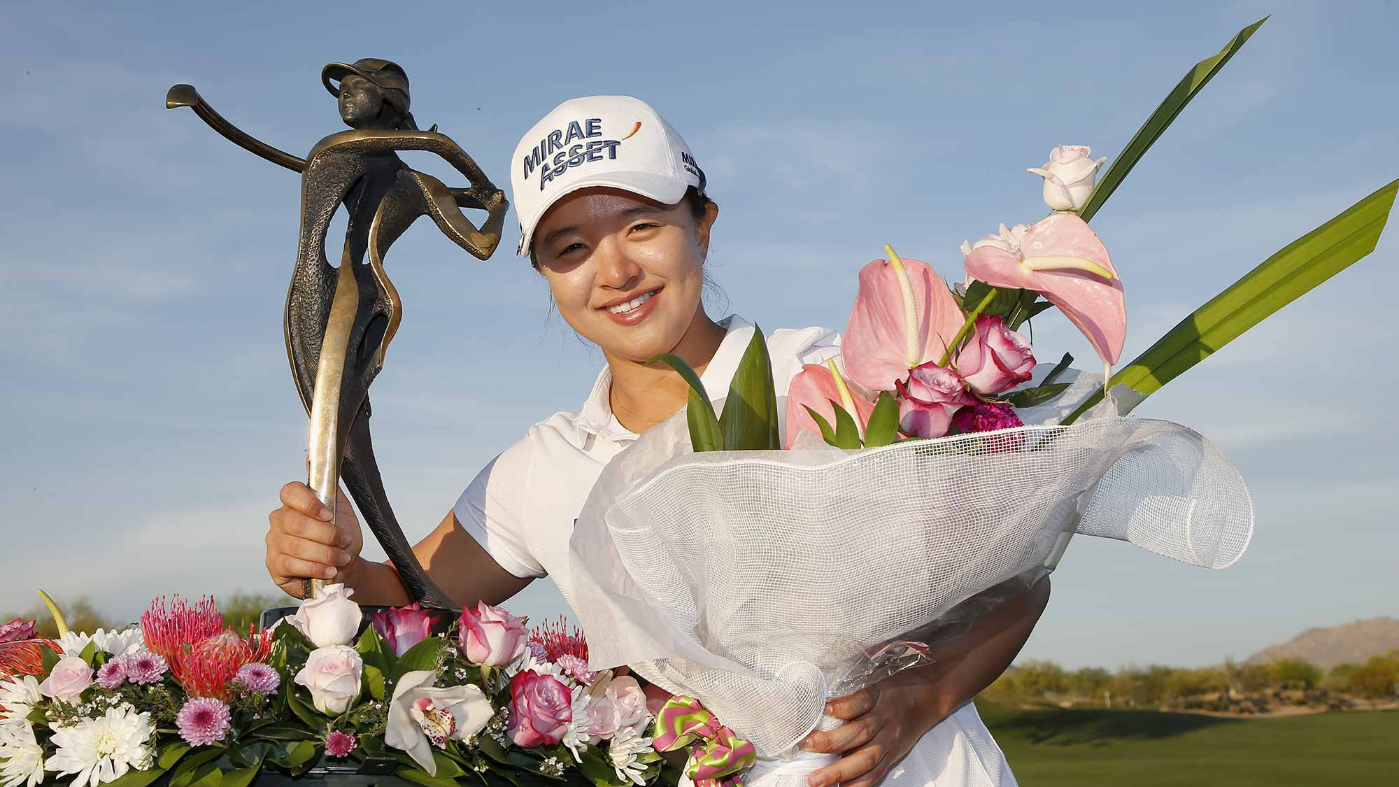 Sei Young Kim of South Korea celebrates with the trophy after winning the LPGA JTBC Founders Cup at Wildfire Golf Club