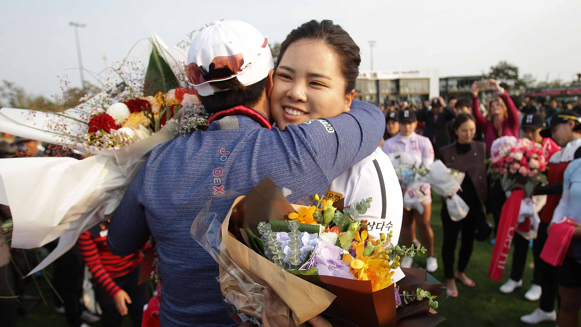 Se-Ri Pak of South Korea hugs with Inbee Park of South Korea during her retirement ceremony on the 18th green after the first round of the LPGA KEB-Hana Bank Championship at the Sky 72 Golf Club Ocean Course