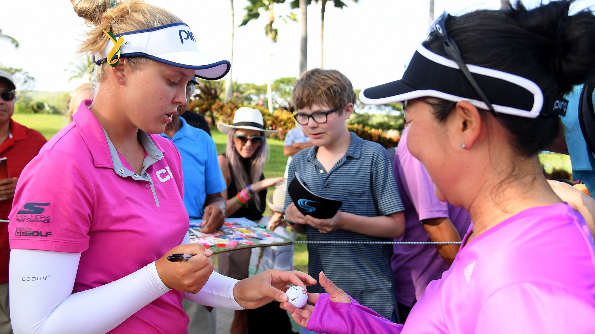 Brooke Signs an Autograph at the LOTTE Championship