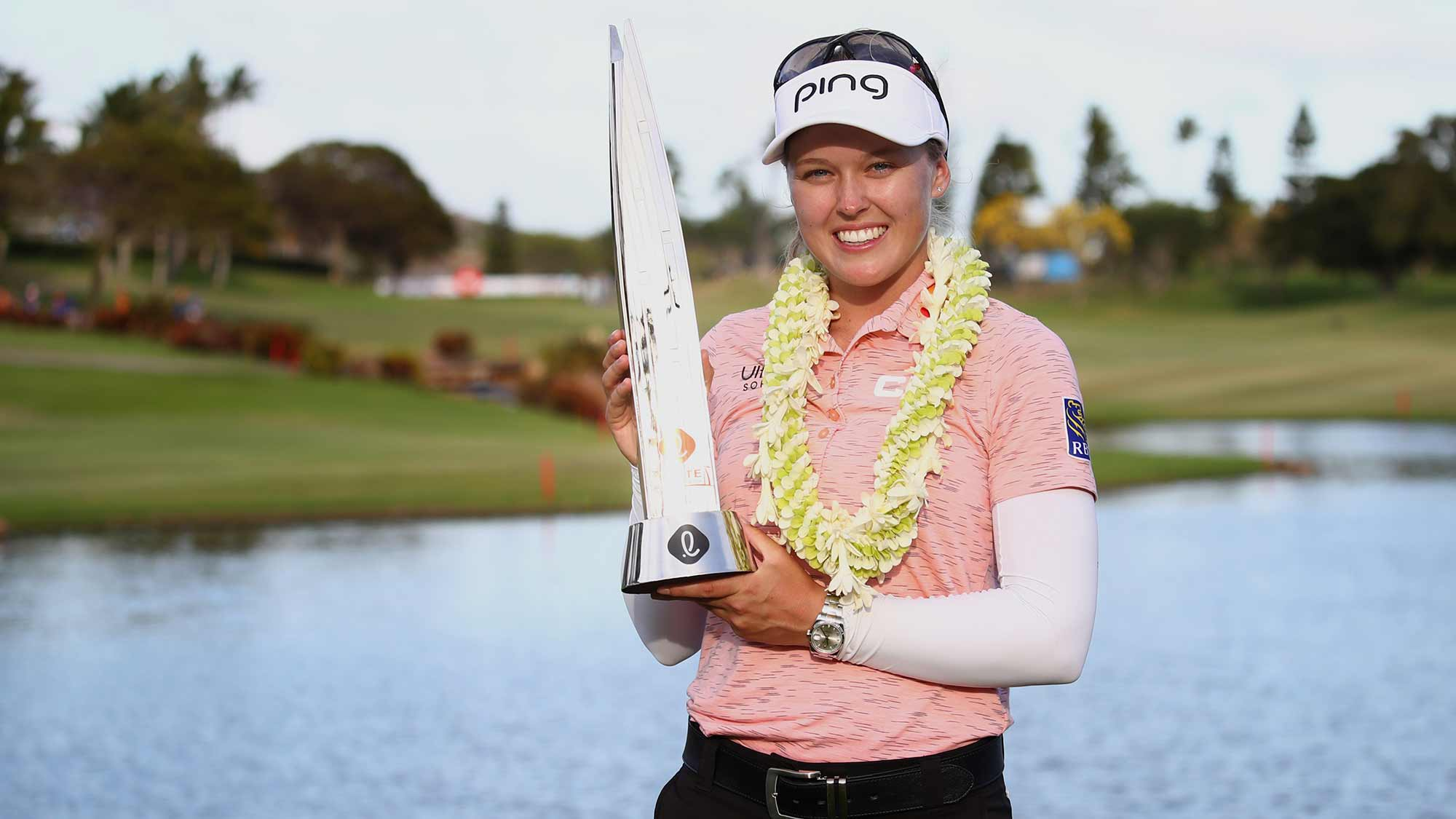 Brooke Henderson poses with the trophy after winning the LOTTE Championship at Ko Olina Golf Club on April 21, 2019 in Kapolei, Hawaii