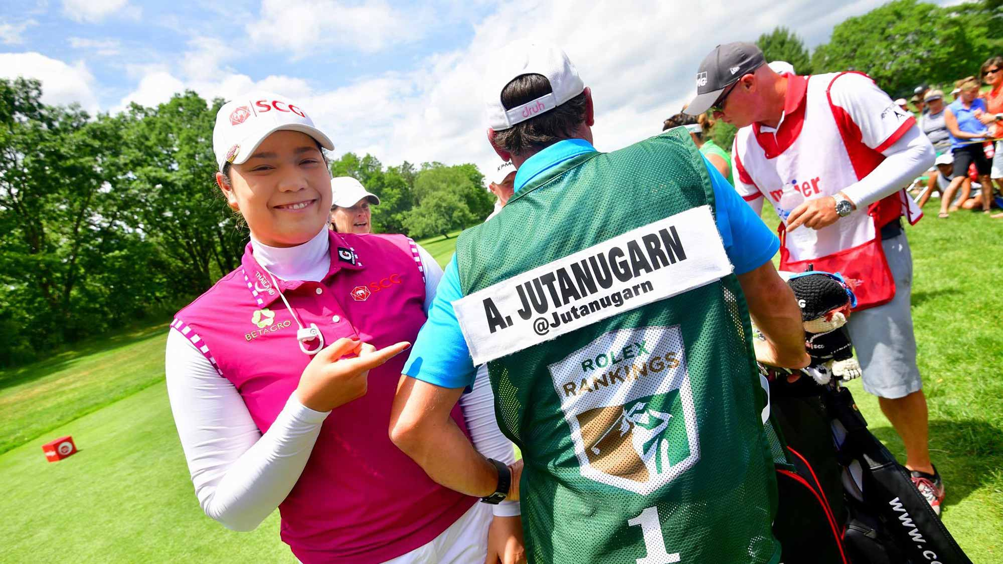 Ariya Jutanugarn Receives No. 1 Rolex Rankings Caddie Bib On First Tee During Opening Round of Meijer LPGA Classic for Simply Give