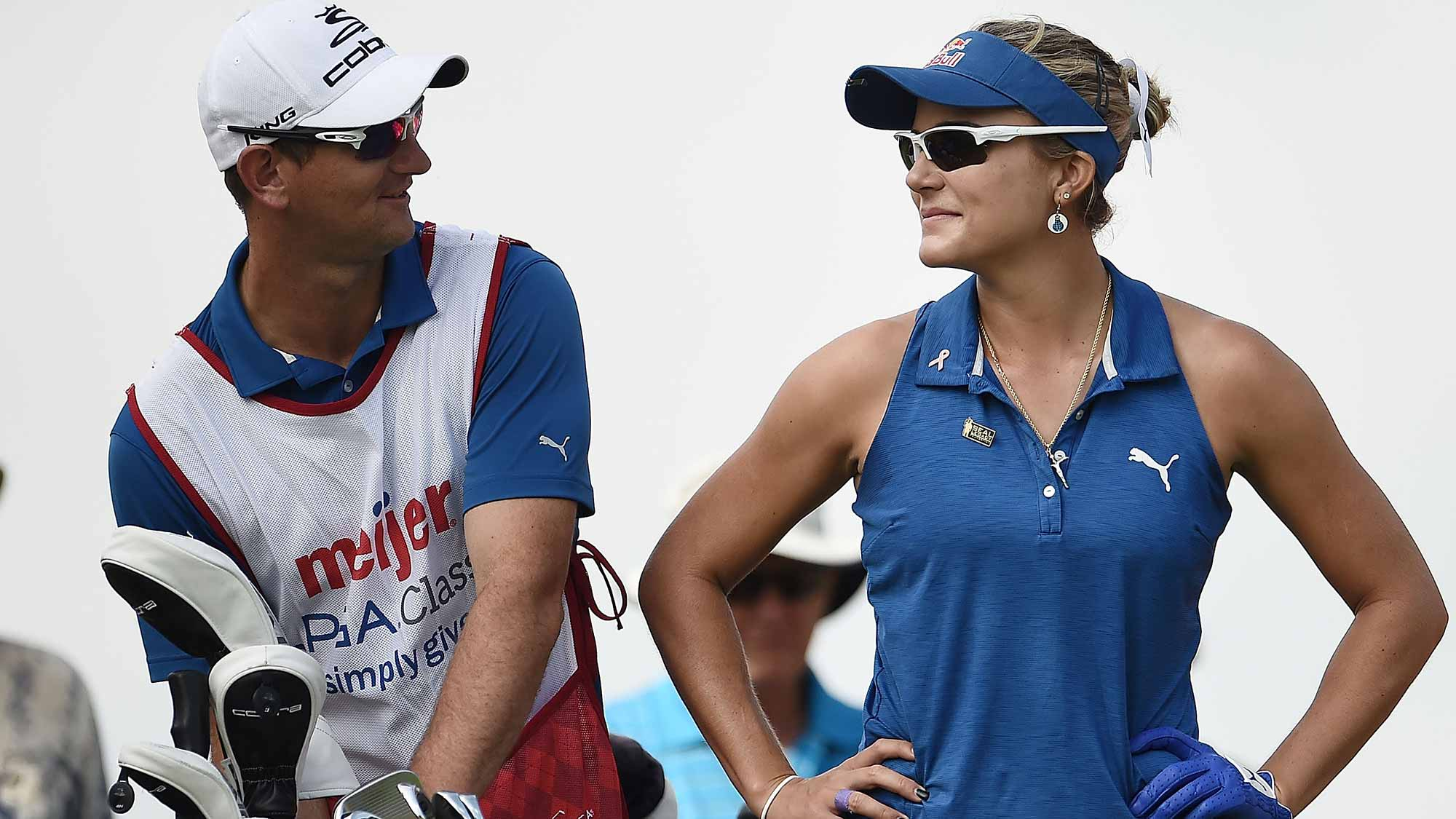 Lexi Thompson speaks with her caddie on the 15th tee during the first round of the Meijer LPGA Classic at Blythefield Country Club