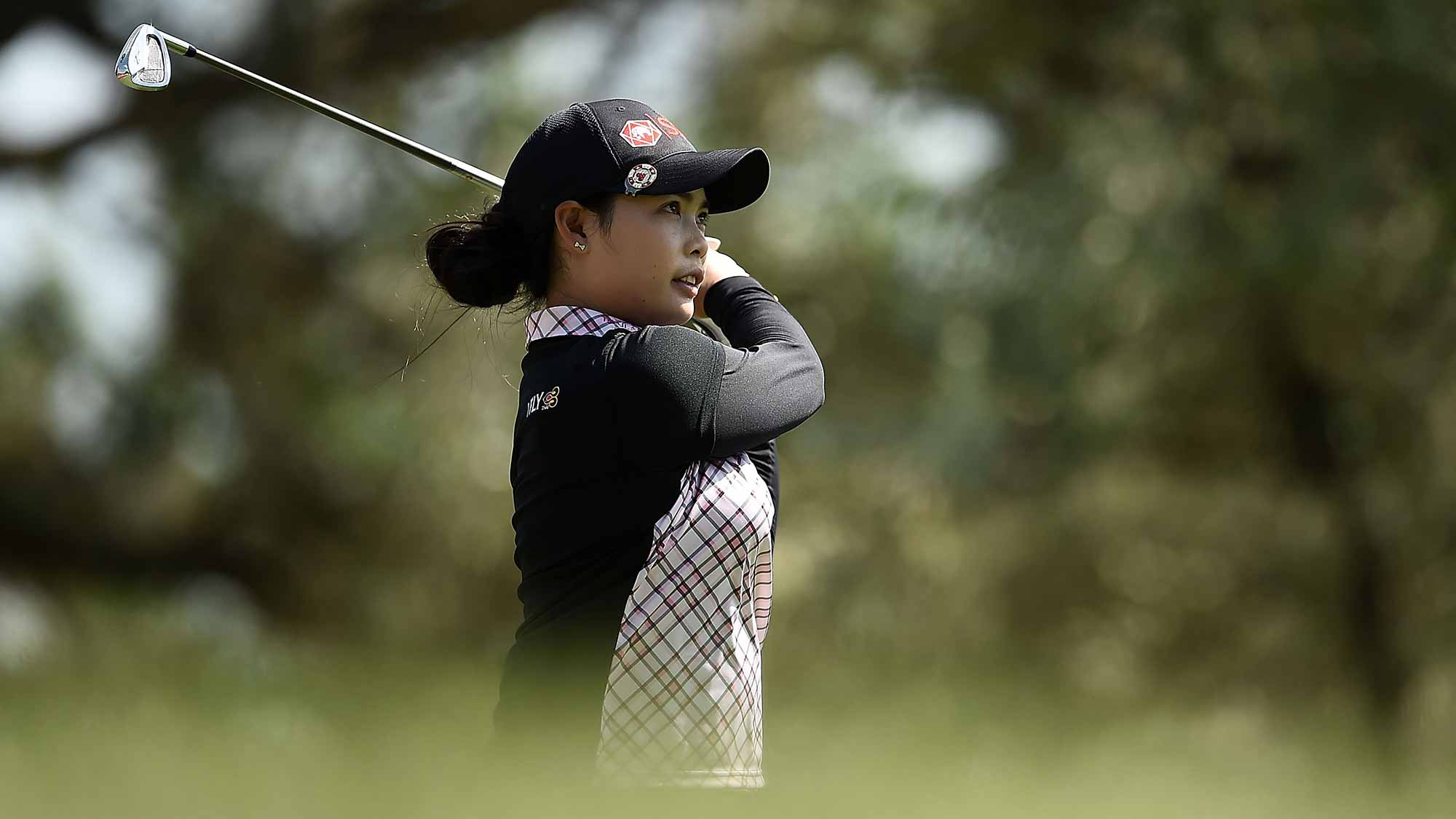 Moriya Jutanugarn of Thailand watches her tee shot on the 12th hole during the first round of the Meijer LPGA Classic at Blythefield Country Club