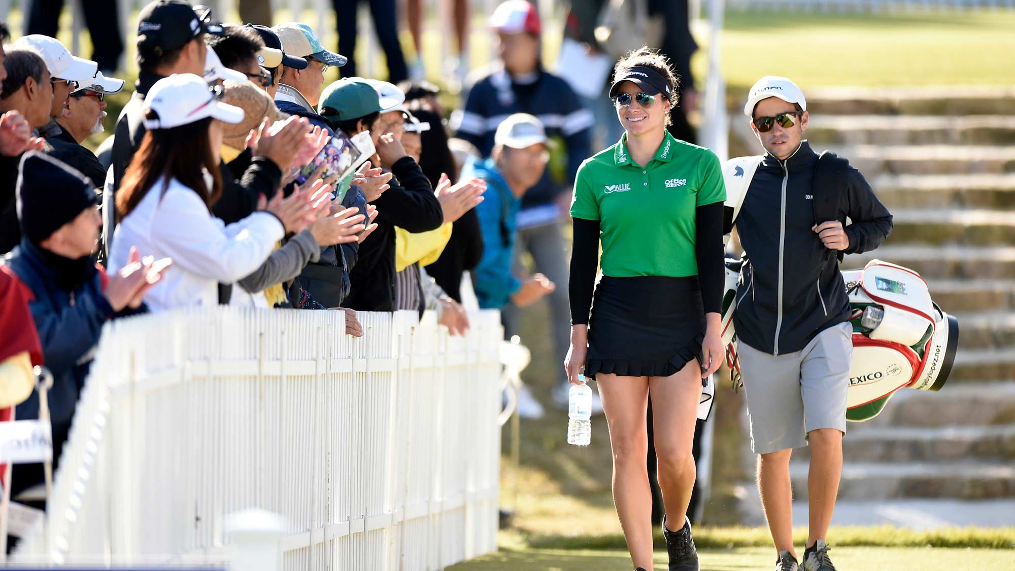 Gaby Lopez walks to first tee