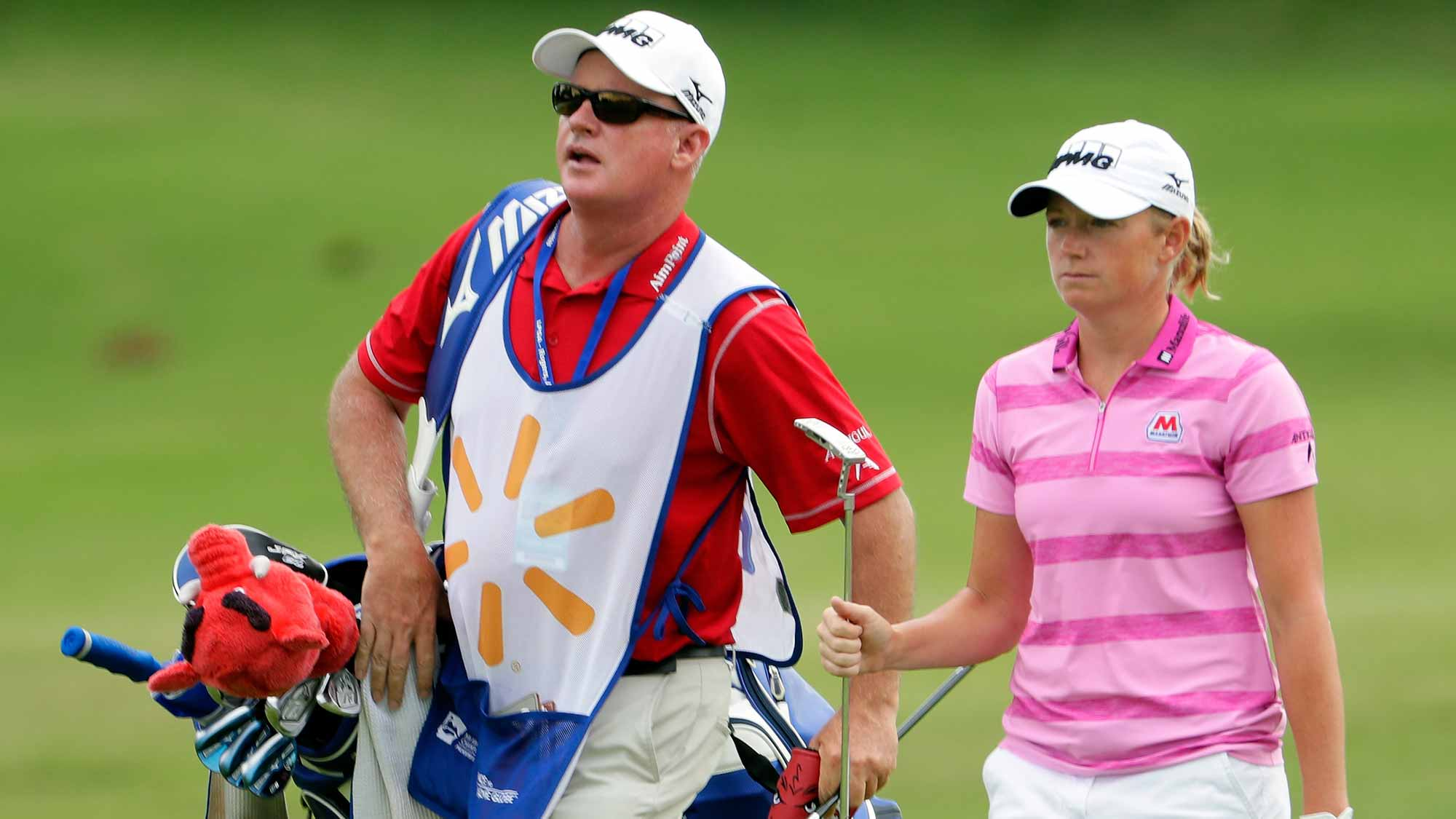 Stacy Lewis walks up the fairway alongside her caddie on the 10th hole during the first round of the Walmart NW Arkansas Championship Presented by P&G