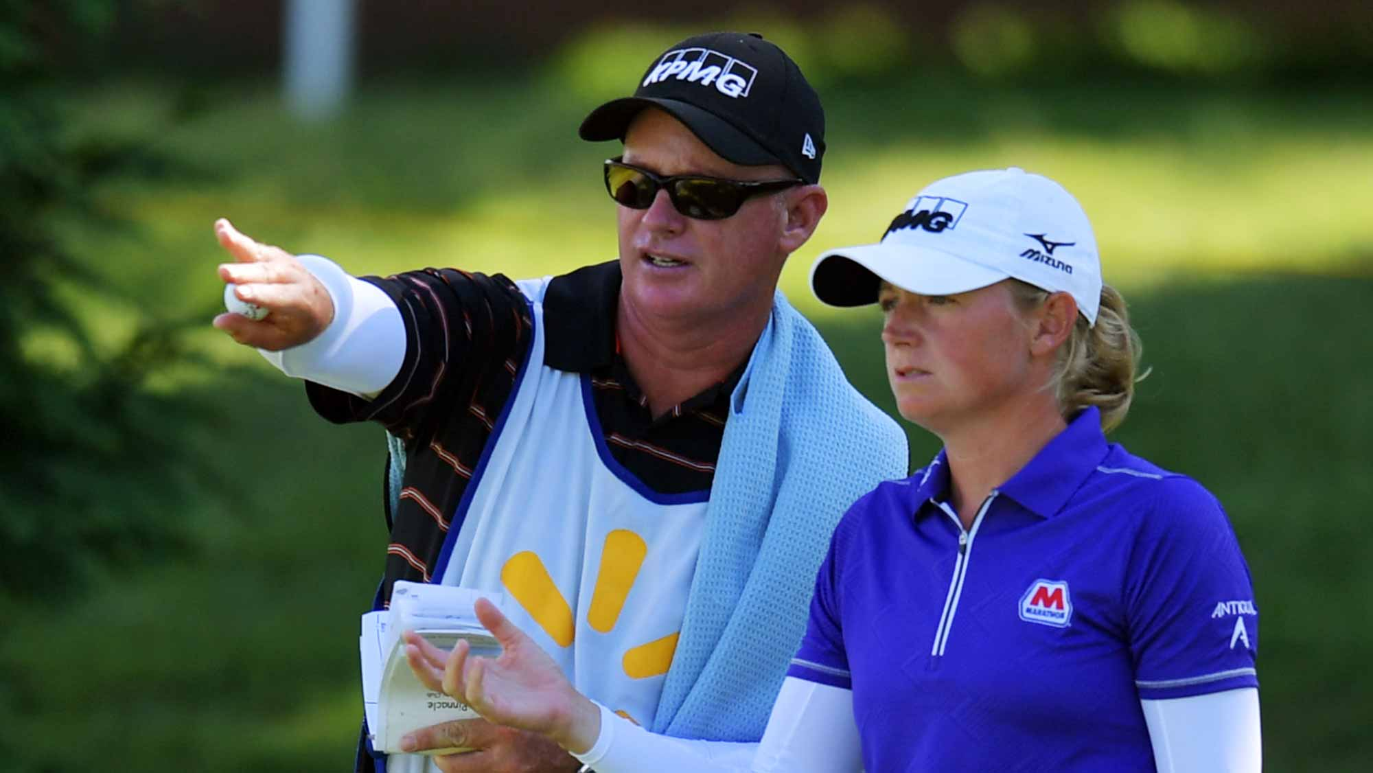 Stacy Lewis consults with her caddie on the 14th hole during the second round of the Walmart NW Arkansas Championship Presented by P&G